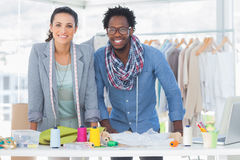 Two fashion designers smiling Stock Photos