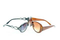Two fashion eyewear. The eyewear looking at the eyewear on white background Stock Images