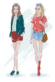 Two fashion girl: blonde and brunette girls. Hand drawn women with accessories. Sketch. Royalty Free Stock Images