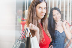 Two fashion girlfriends shopping at Christmas Royalty Free Stock Photography
