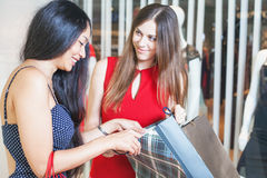 Two fashion girlfriends shopping at mall Stock Photos