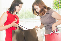 Two fashion girlfriends shopping at mall Stock Image