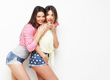 Two fashion laughing painted girl friends hugging and having fun Royalty Free Stock Photography