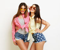Two fashion laughing painted girl friends hugging and having fun Stock Photos