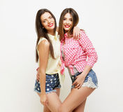 Two fashion laughing painted girl friends hugging and having fun Royalty Free Stock Photos