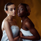 Two fashion model. Two beautiful women of different nationalities. Studio portrait Royalty Free Stock Photo