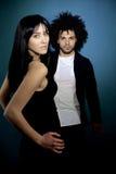Two fashion model posing looking camera sensual. Couple of models posing intense Royalty Free Stock Photos