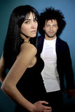 Two fashion model posing looking camera sensual man out of focus. Couple of models posing intense Stock Image