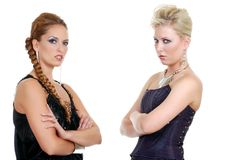 Two fashion models with attitude. Isolated two fashion models with attitude on a white background royalty free stock photo