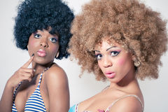 Two fashion models with dolls styled look royalty free stock photo