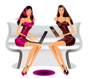 Two fashion models with laptop and tablet Royalty Free Stock Images