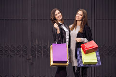 Two fashion models shopping royalty free stock photos