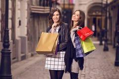 Two fashion models shopping Stock Photos