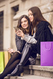 Two fashion models shopping Royalty Free Stock Images