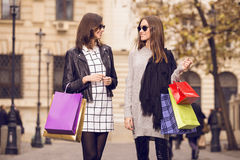 Two fashion models shopping Royalty Free Stock Photos