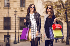 Two fashion models shopping Stock Images