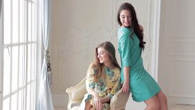 Two fashion models in summer dresses posing at photo shoot in studio stock video footage