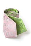 Two fashion ties wrapped together. Green and pink ties wrapped together on white background Royalty Free Stock Images