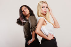 Two fashion women african and caucasian posing Stock Photos