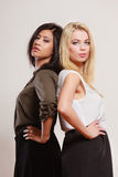 Two fashion women african and caucasian posing Stock Photo
