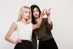 Two fashion women pointing wit finger Royalty Free Stock Photo