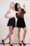 Two fashion women pointing wit finger Royalty Free Stock Image
