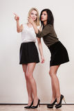 Two fashion women pointing wit finger Stock Photography