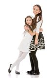Two fashionable, beautiful girls sisters having Royalty Free Stock Photography