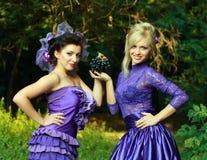 Two fashionable beautiful women Royalty Free Stock Photos