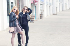 Two fashionable friends in outdoor shooting Stock Image