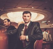 Two fashionable men in a casino Stock Photography