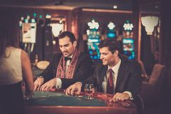 Two fashionable men in  a casino Stock Image