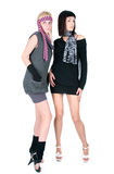 Two fashionable pretty Women standing and posing Royalty Free Stock Photos