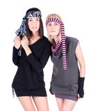 Two fashionable pretty Women standing and posing Stock Photography