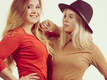 Two fashionable female friends stock photo