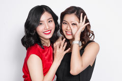 Two fashionable women in nice dresses standing together and havi Stock Photography