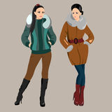 Two fashionable women in winter clothes Royalty Free Stock Image