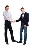 Two fashionable young men greet each other Royalty Free Stock Images