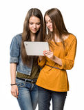 Teenagers having fun with a tablet computer. Stock Photo