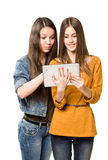 Teenagers having fun with a tablet computer. Royalty Free Stock Photos