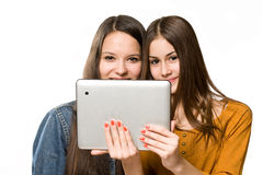 Teenagers having fun with a tablet computer. Royalty Free Stock Images