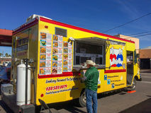 Two Fat Guys Grilled Cheese and a Yeallow Truck Royalty Free Stock Photo