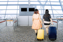 Two fat women with suitcases Royalty Free Stock Photos
