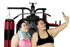 Two fat women taking selfie after exercise Royalty Free Stock Images