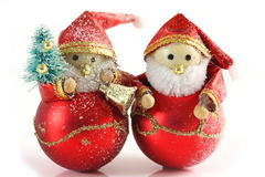 Two Father Christmas figures. On a white background royalty free stock photos