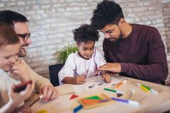 Two fathers play educational games with their children. Having fun Stock Photos
