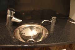 Two faucets, a sink and ceramics in the kitchen Stock Image