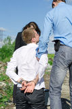 Two FBI agents conduct arrest Stock Photo