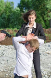 Two FBI agents conduct arrest. Of an offender Royalty Free Stock Photos