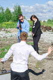 Two FBI agents conduct arrest of an offender. With the gun royalty free stock photography